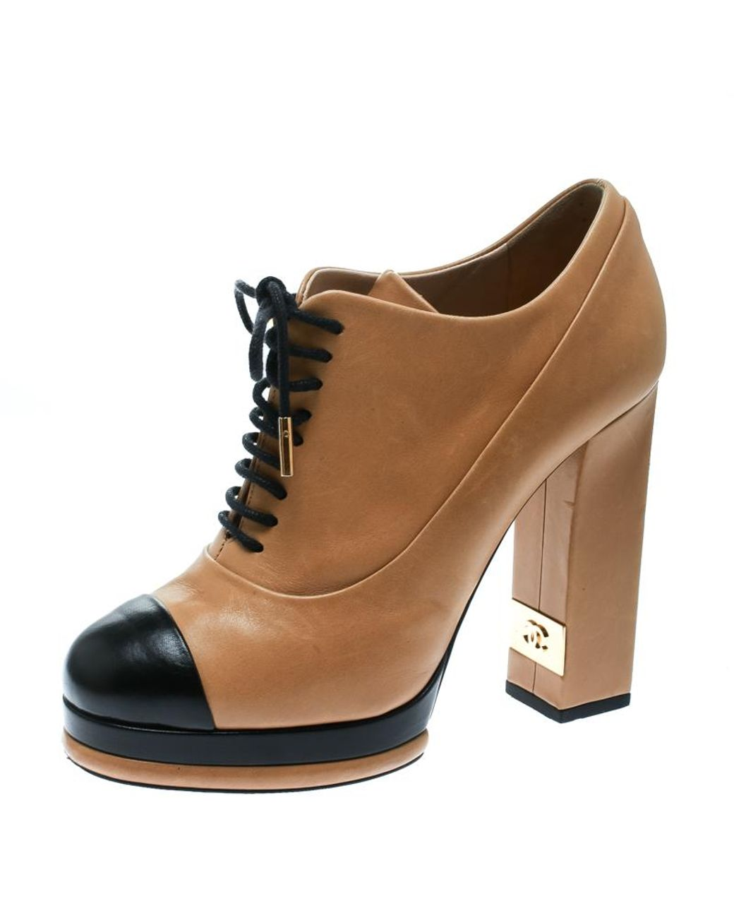 02a8ef540600b Chanel Beige/black Leather Cap Toe Platform Ankle Boots Size 40 in Natural  - Save 24% - Lyst