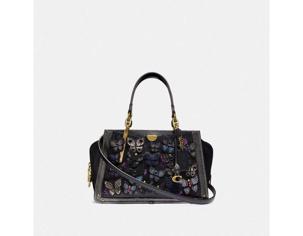 Coach dreamer with butterfly applique and snakeskin detail in