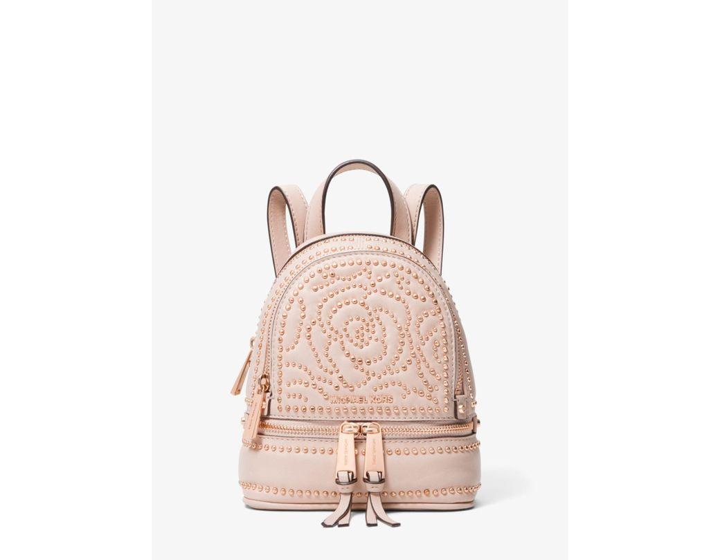 f77977aa9b17 Lyst - Michael Kors Rhea Mini Rose Studded Leather Backpack in Pink ...