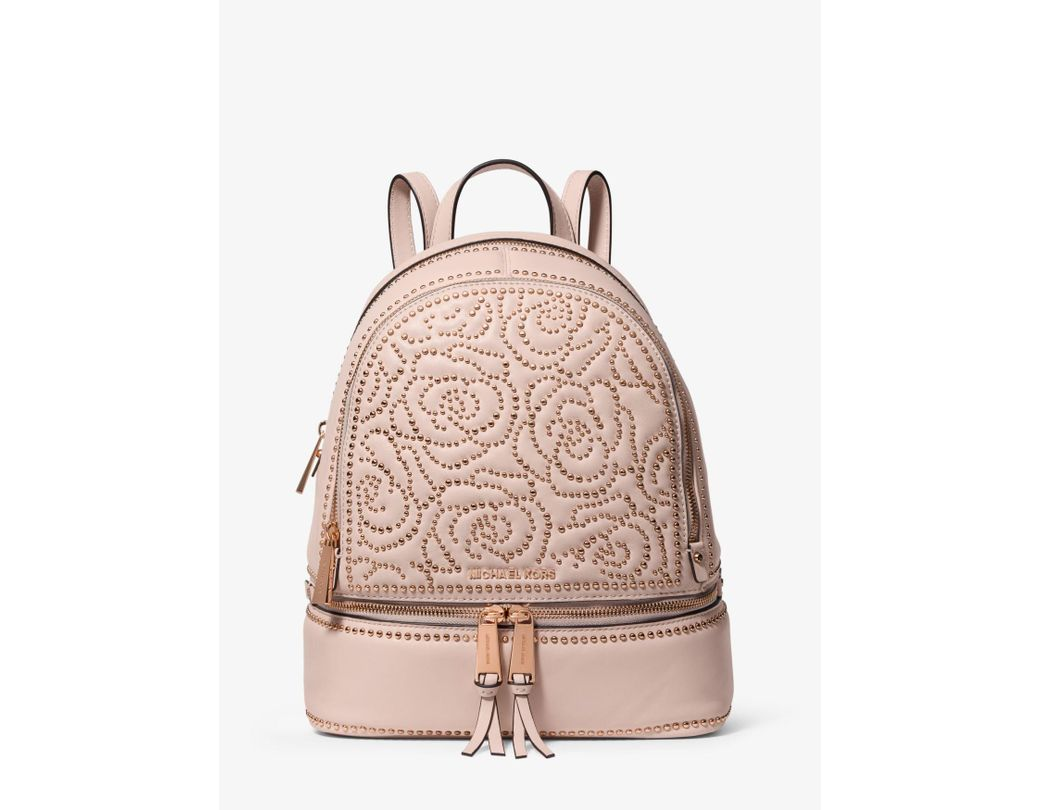 e09d360f114d Lyst - MICHAEL Michael Kors Rhea Medium Rose Studded Leather Backpack in  Pink - Save 28%