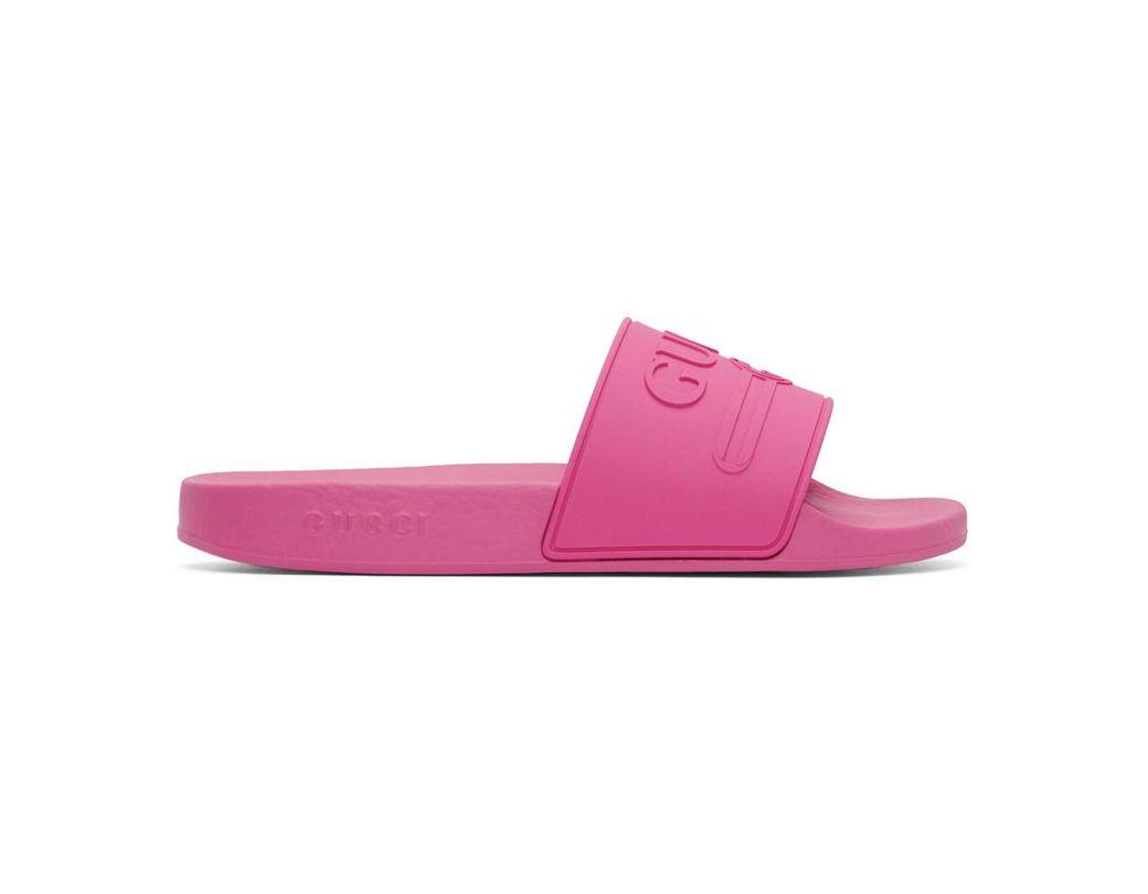 8833e7d40f8a Lyst - Gucci Logo Rubber Slide Sandal in Pink for Men - Save 38%