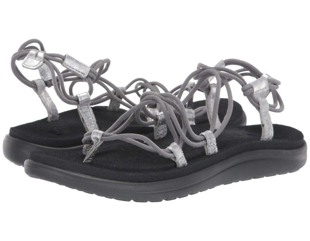 1272566562b2 Lyst - Teva Voya Infinity Metallic (black gold) Women s Shoes in ...