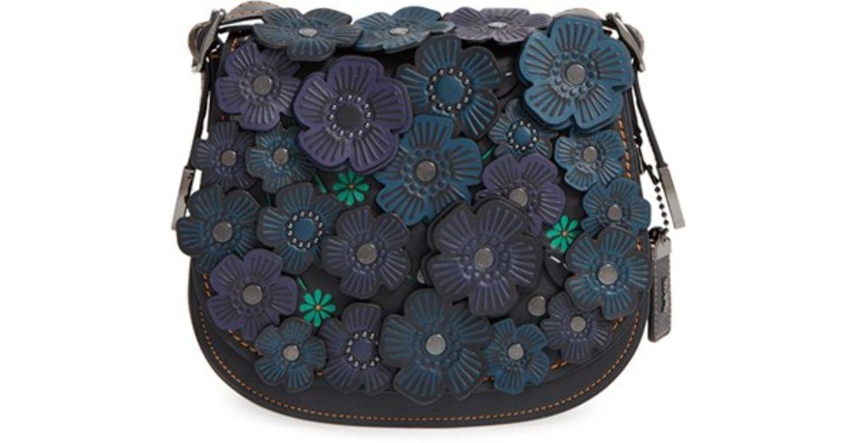 Coach flower applique leather saddle bag in black lyst