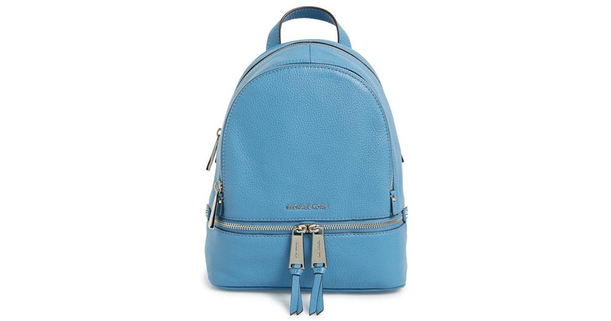 0c6edb2ab6ce ... michl kors rhea backpack 62ecd 5f33e  where can i buy lyst michael  michael kors small rhea zip leather backpack in blue 62ed7
