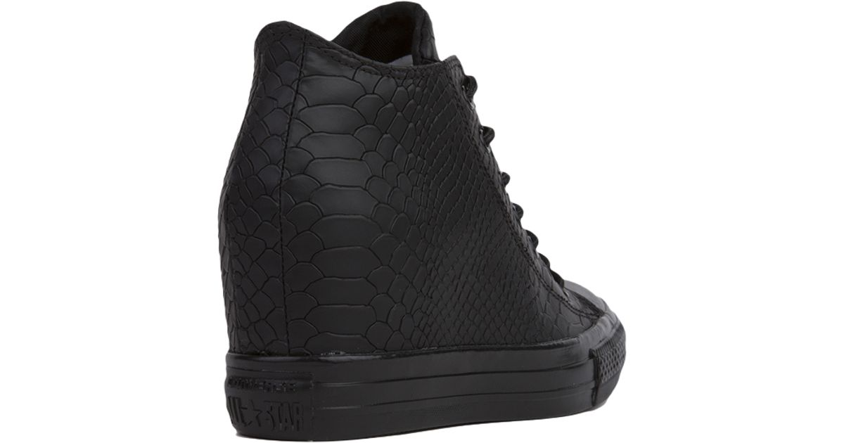 858c11c5ac39 Lyst - Converse Chuck Taylor All Star Lux Embossed Reptile Mid Top Sneaker  Wedges - Black in Black