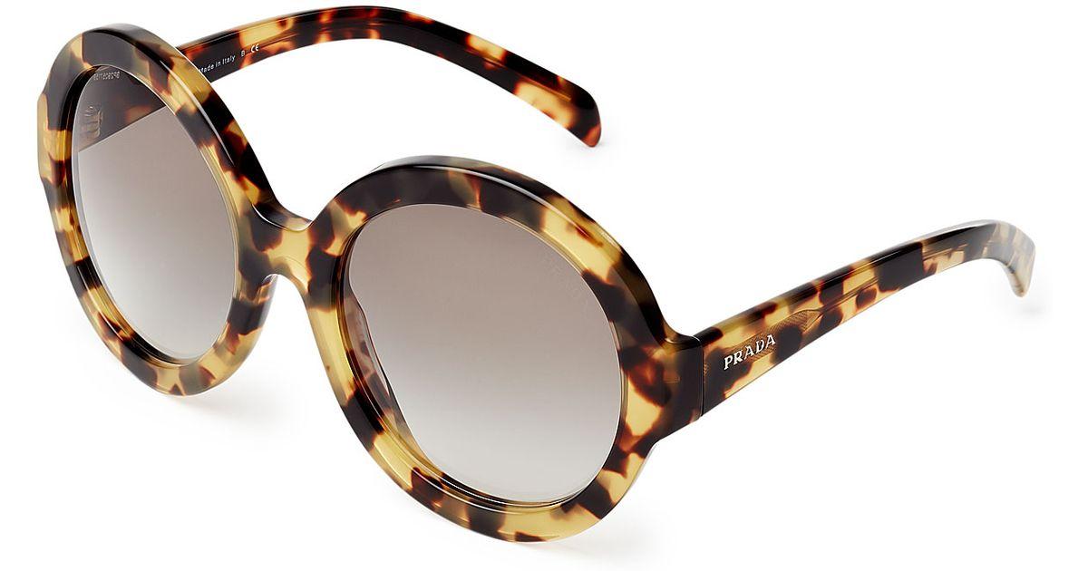 66f11637ac ... discount lyst prada pr06rs oversize round sunglasses animal prints in  brown 6c400 abad0