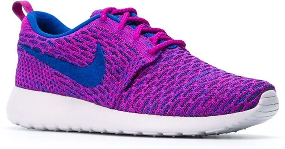pretty nice 8ca63 d8913 ... france lyst nike roshe run flyknit sneakers in pink 60721 5768f