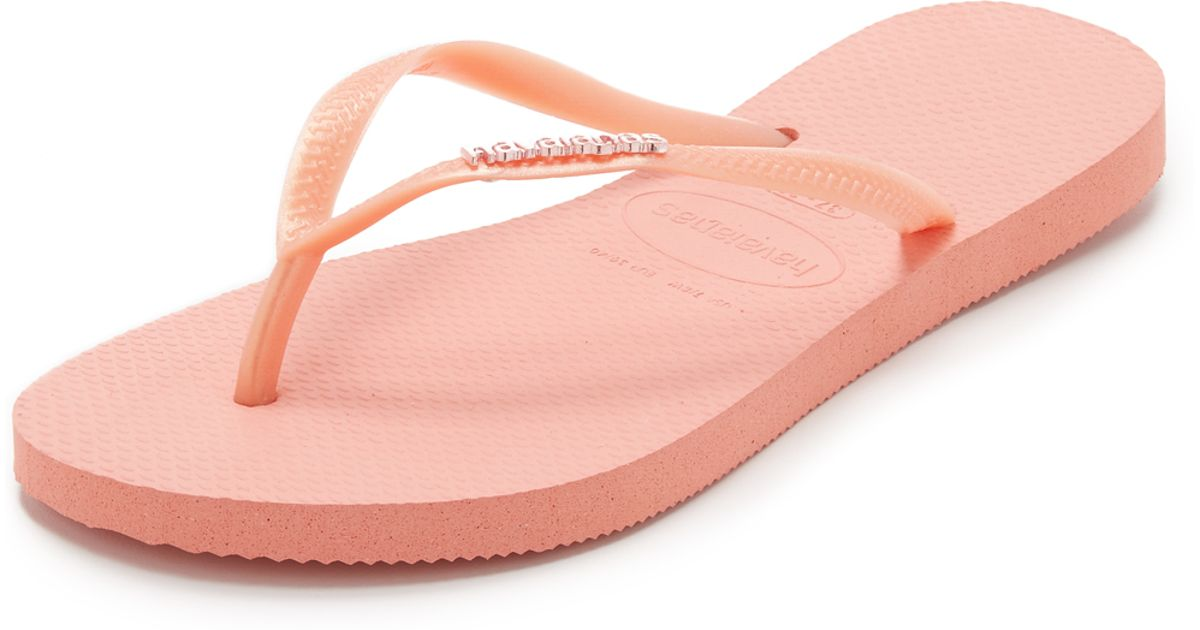 b0c578618 Havaianas Slim Logo Metallic Flip Flops in Pink - Lyst