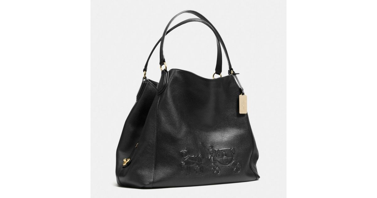 ed4f2a7869 Lyst - COACH Embossed Horse And Carriage Large Edie Shoulder Bag In Pebble  Leather in Black