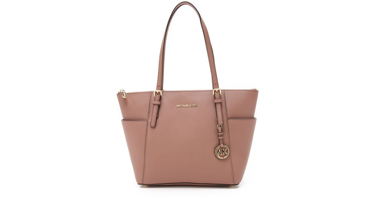 588a91e14e6d ... promo code michael michael kors jet set top zip tote dusty rose in pink  lyst 02892