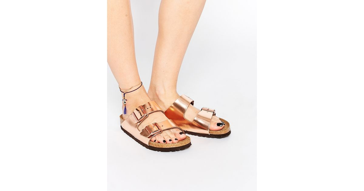 75e30348841 Lyst - Birkenstock Arizona Metallic Copper Slider Flat Sandals in Pink