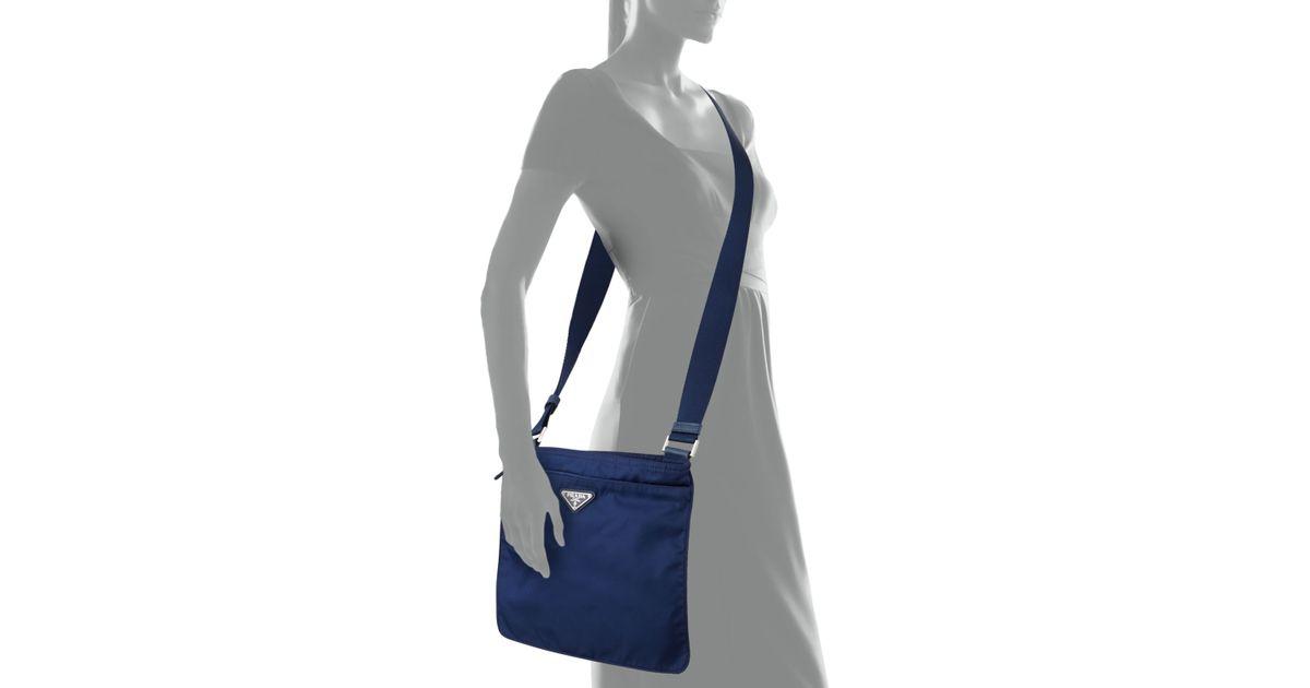 d19fda1054f6 ... coupon for lyst prada vela flat crossbody bag in blue 9d071 59afa