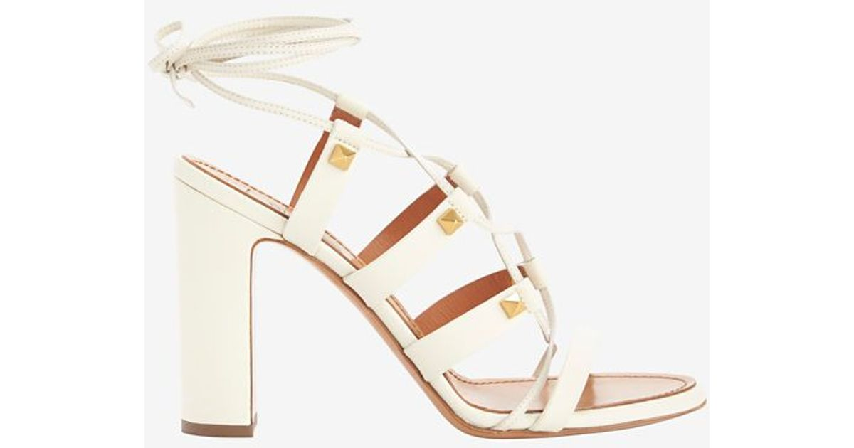 2bc907430cd Lyst - Valentino Rockstud Chunky Heel Lace Up Gladiator Sandals in White