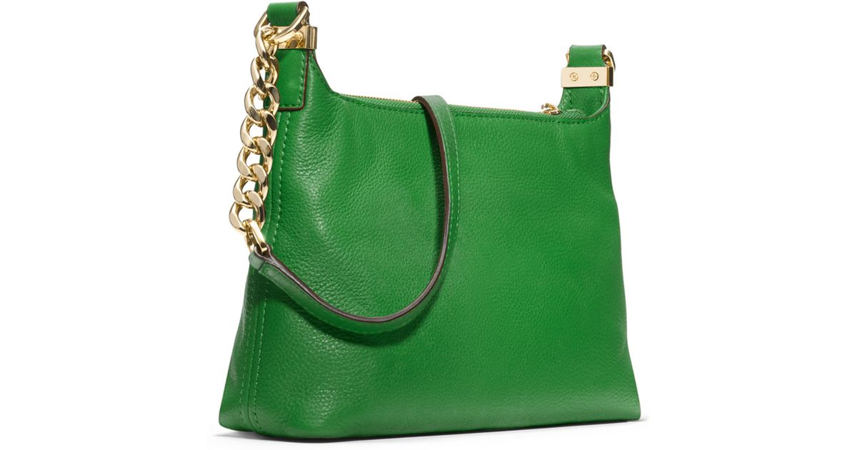 91a21d6f8c6bff ... get lyst michael michael kors small bedford tassel pebbled messenger bag  in green 5ae4e 41cee