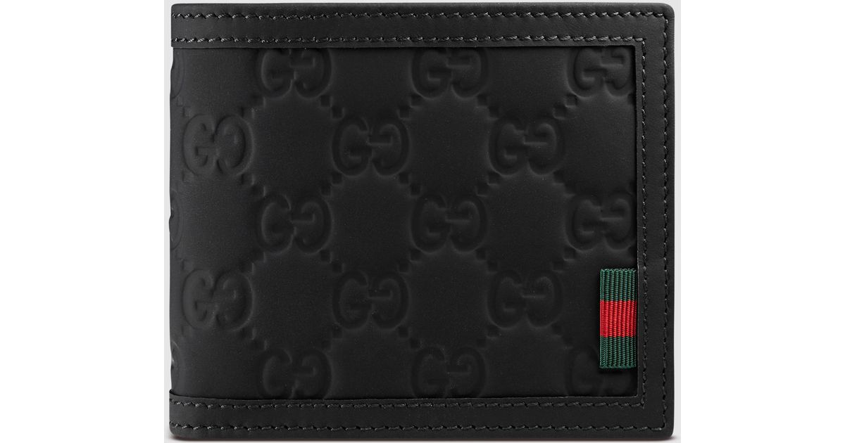 150a62ef20b4 Lyst Gucci Rubber Ssima Leather Bi Fold Wallet In Black For Men