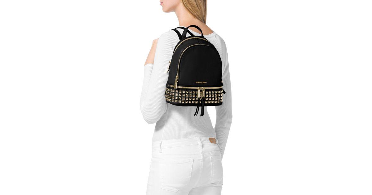 679b9bddb7b2 Lyst - MICHAEL Michael Kors Extra Small Rhea Zip Studded Backpack in Black