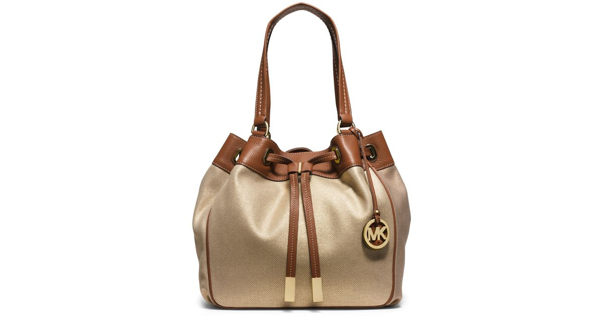 f385079047571e Michael Kors Marina Large Canvas Drawstring Tote in Metallic - Lyst