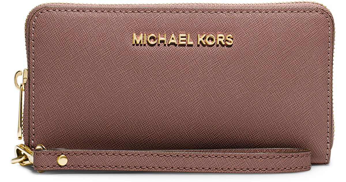c17a2f050a98 ... pale gold d0807 728e2; aliexpress lyst michael michael kors jet set  travel saffiano multifunction tech wristlet wallet in brown 05f1e