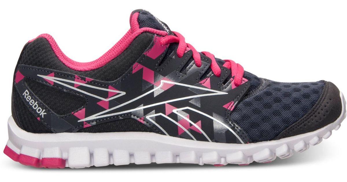 f7a56dd8f9283e Lyst - Reebok Womens Realflex Scream 30 Running Sneakers From Finish Line  in Pink