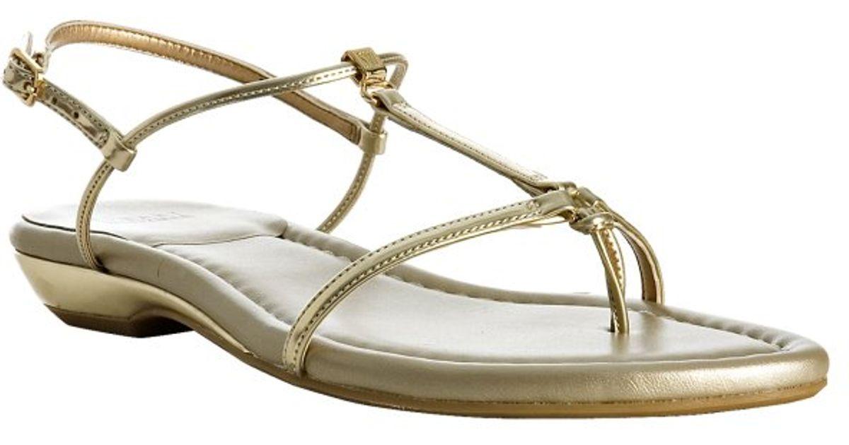 6898de999e9aa Lyst - Stuart Weitzman Gold Leather Itsybitsy T-strap Sandals in Metallic