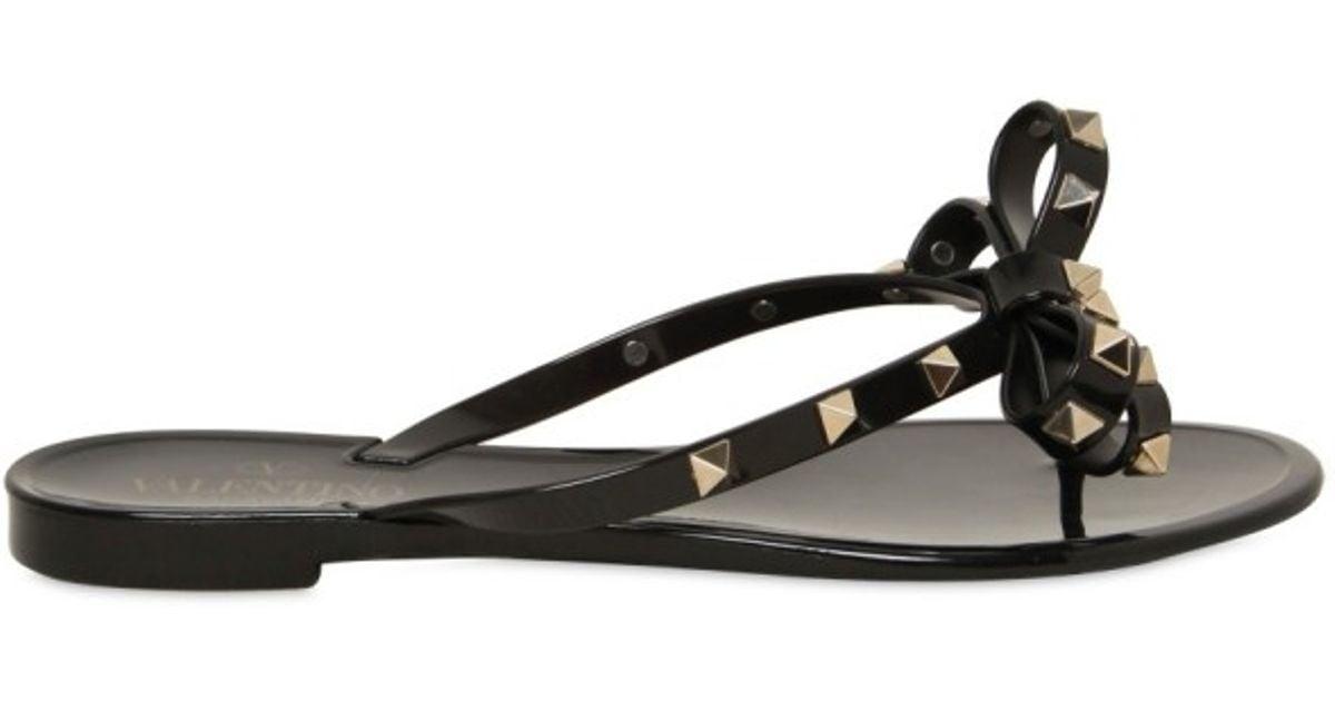 032358584db60 ... Lyst - Valentino Rubber Bow Studs Flip Flop Flats in Black new cheap  2fa1e 2403f ...
