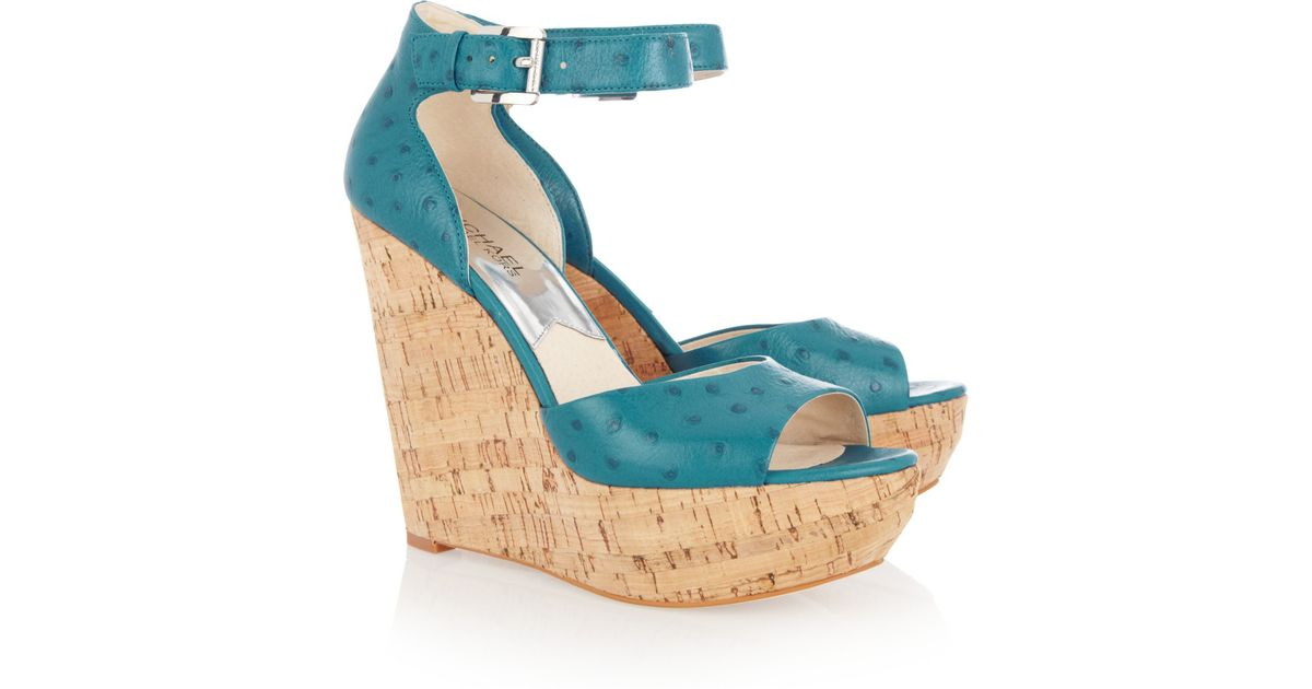 d4660a94482 Lyst - MICHAEL Michael Kors Ariana Ostrich-Effect Leather Wedge Sandals in  Blue