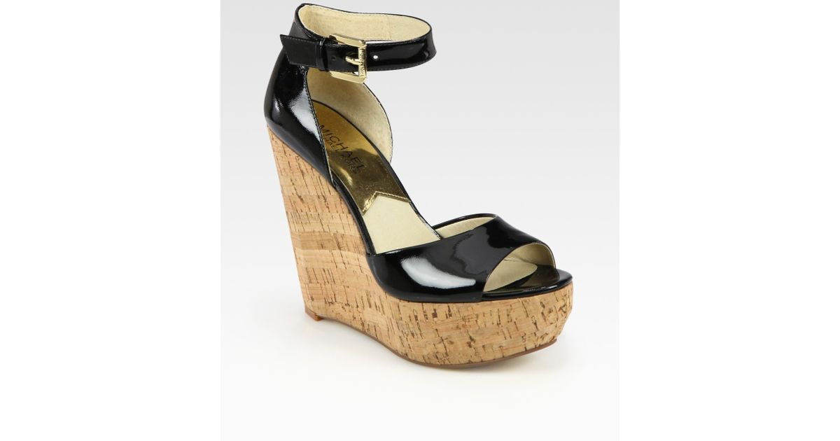 917c08a7c29 Lyst - MICHAEL Michael Kors Ariana Patent Leather Cork Wedge Sandals in  Black