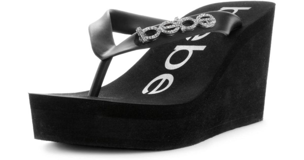 253d7dda71025 Lyst - Bebe Kristy Wedge Flip Flop Sandals in Black