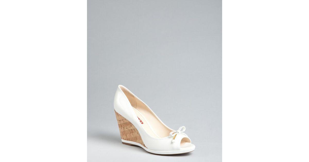 ed4e1079abc9 Lyst - Prada Prada Sport White Patent Leather Peep Toe Cork Wedges in White