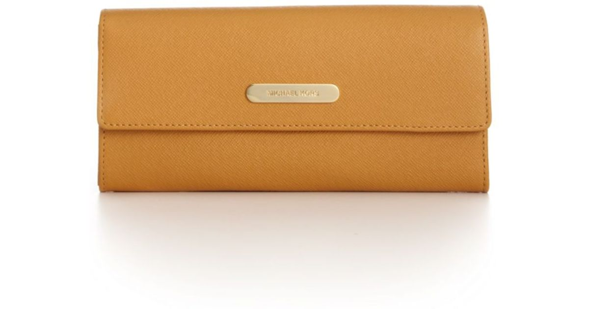 f82a09811e00 Lyst - Michael Kors Saffiano Large Slim Flap Wallet in Brown