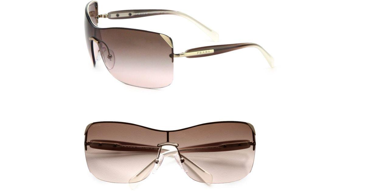 ce5a83eeab9 ... clearance lyst prada rectangular rimless shield sunglasses in metallic  57a05 d8189