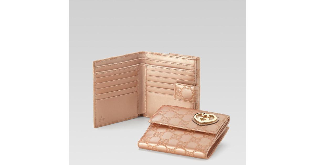 128ccf6eb5b9 Lyst - Gucci Heartshaped Interlocking G Flap French Wallet in Pink