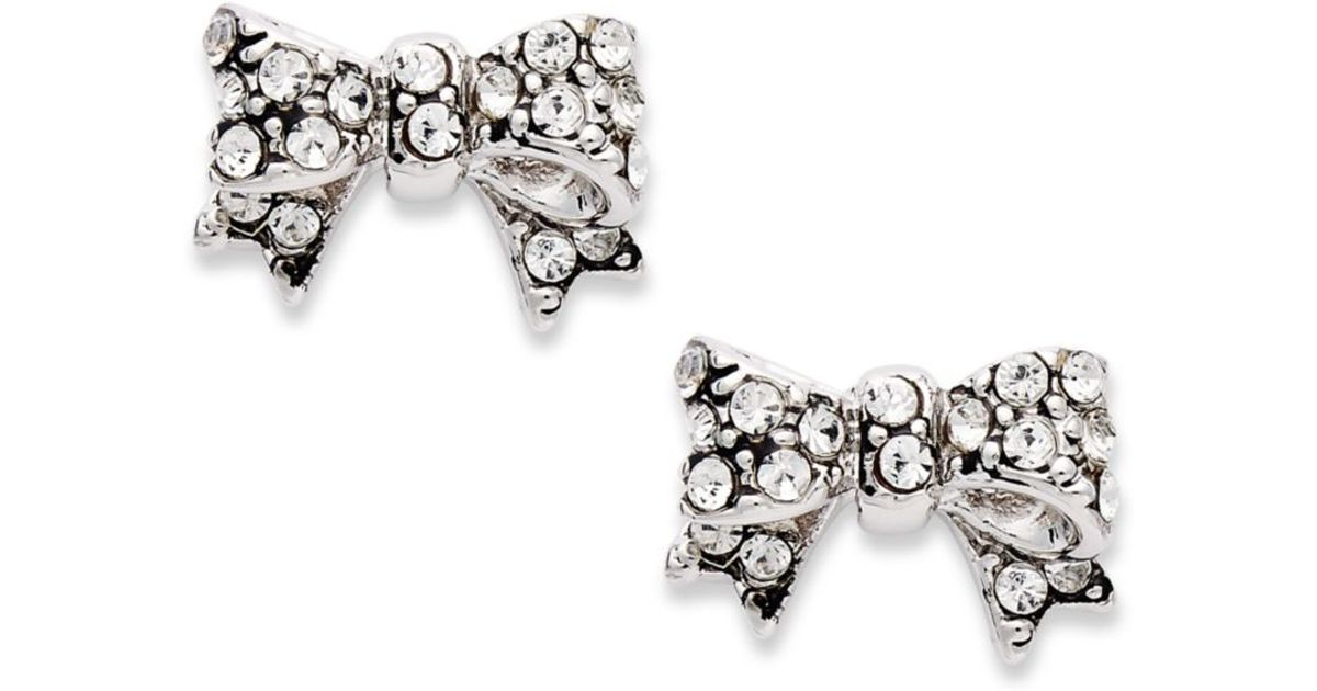 Lyst - Juicy Couture Silver Tone Pave Crystal Bow Stud Earrings in ...