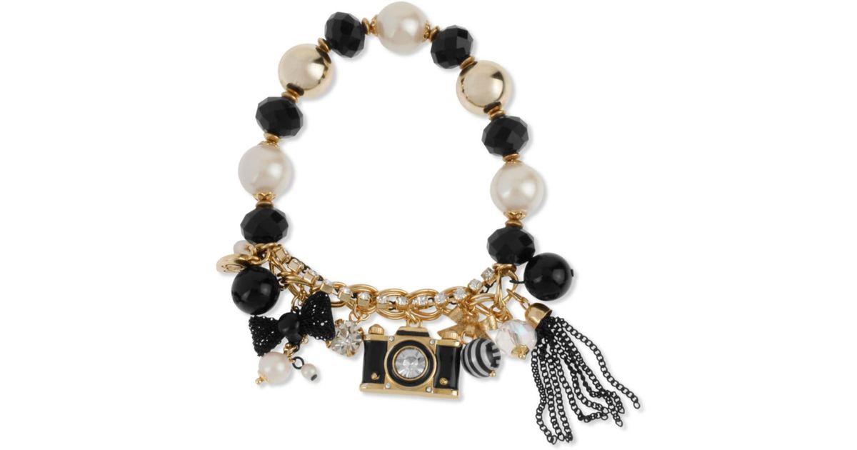 Lyst Betsey Johnson Gold Tone Camera Charm Halfstretch Bracelet In Metallic