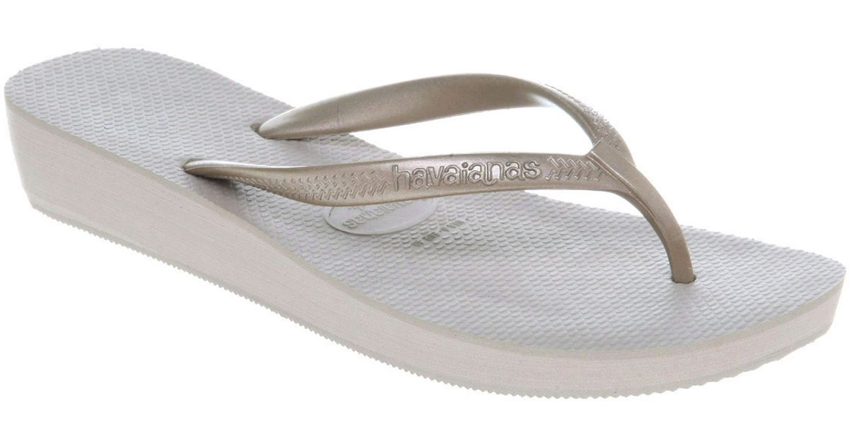 bda454caa54 Lyst - Havaianas Highlight Wedge Flip Flop Gold Rubber in Gray