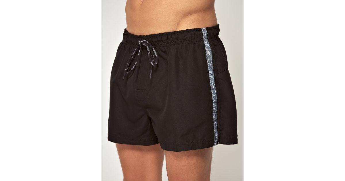 a934d7e0661 Lyst - Calvin Klein Logo Tape Swim Shorts in Black for Men