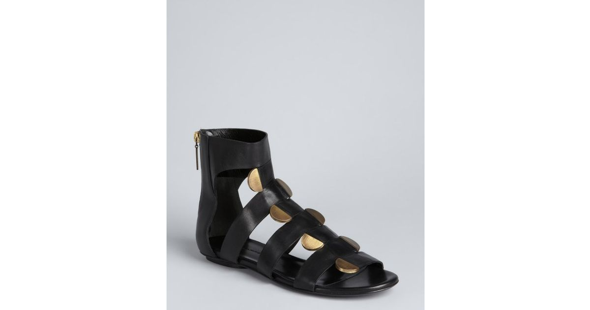 a789c7528cc Lyst - Balenciaga Black Leather and Gold Discs Gladiator Sandals in Black
