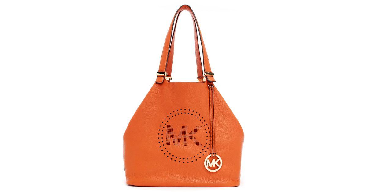 08ff1609b1cd Lyst - MICHAEL Michael Kors Large Perforated Logo Grab Bag in Orange