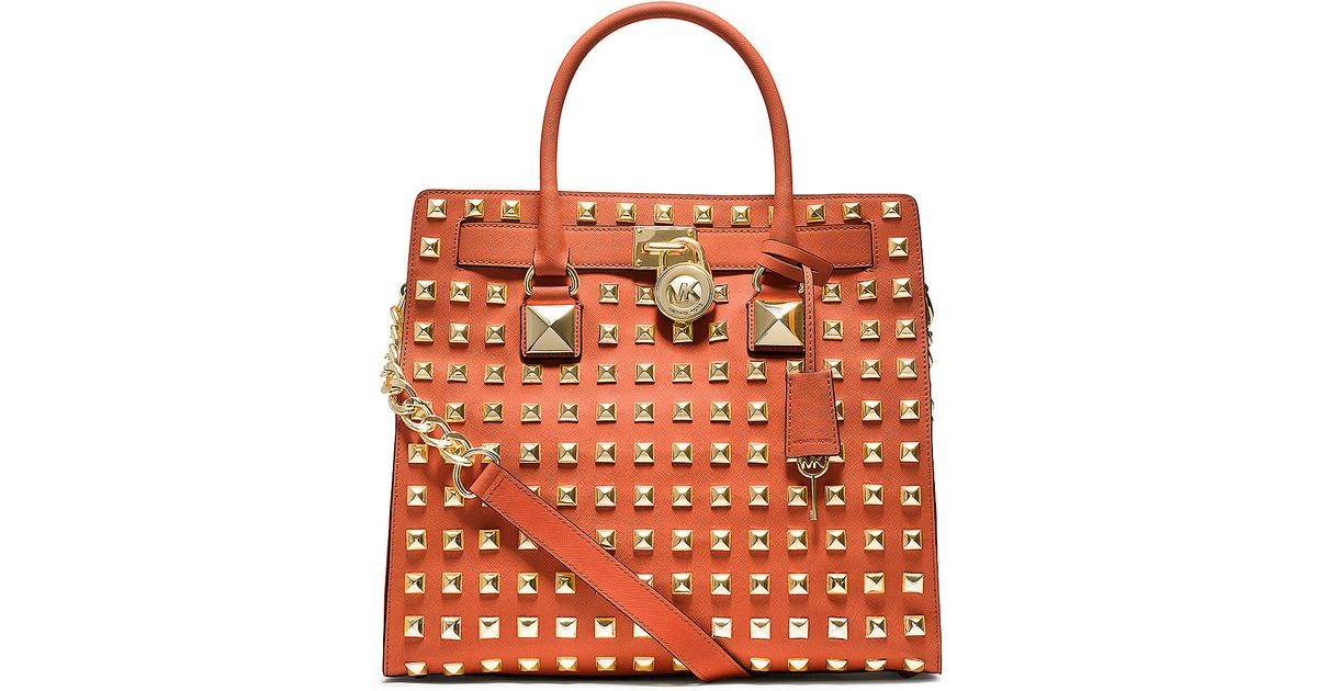 558635e171264f hot michael kors orange studded bag 2a686 844e1