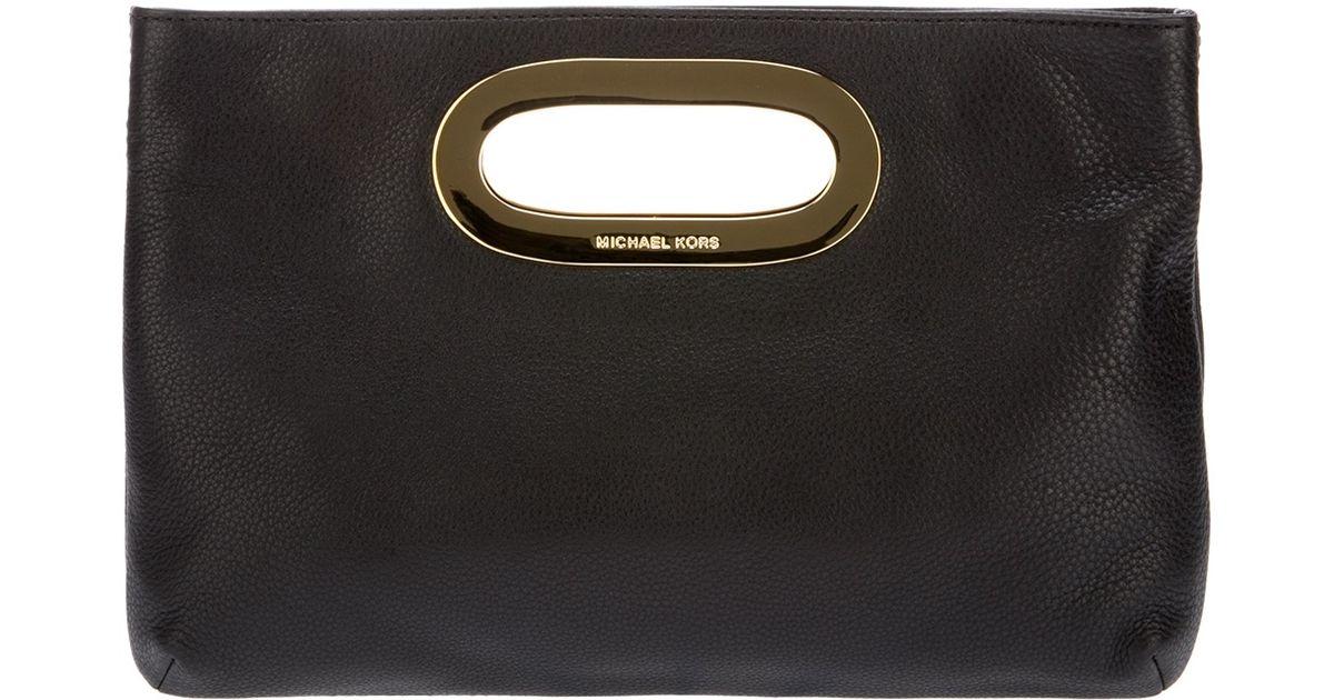 ed19d8393376 ... discount code for michael michael kors berkeley clutch bag in black lyst  05fb9 3fe7b