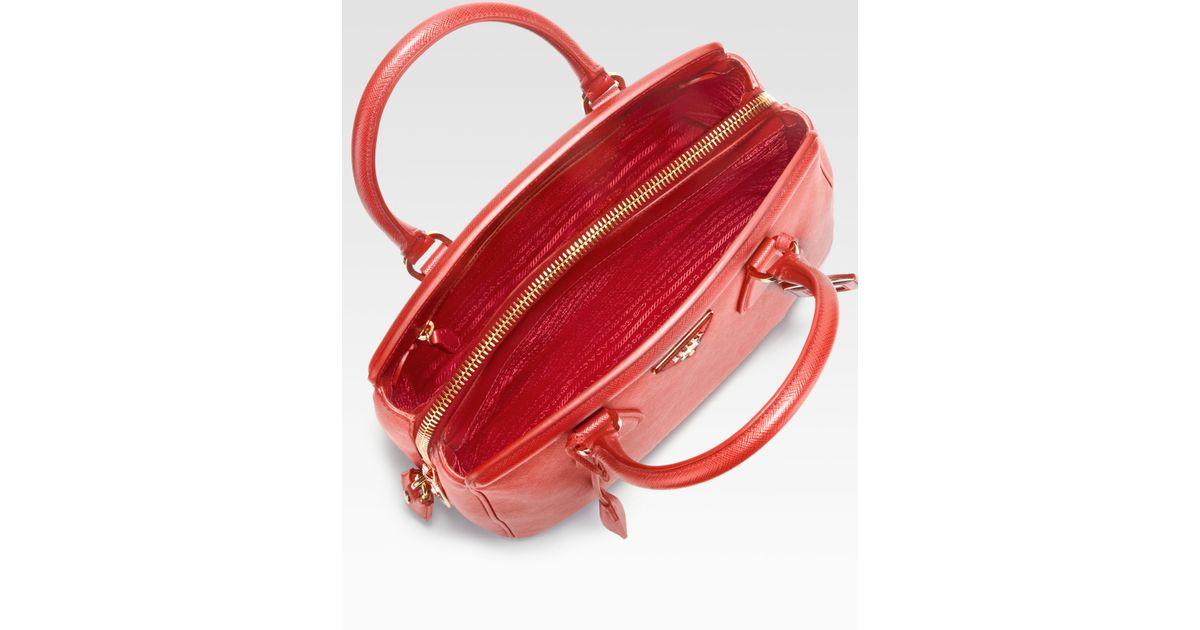 6bc164d11 ... shop blue lyst prada saffiano zip promenade top handle bag in red 55f35  0f405