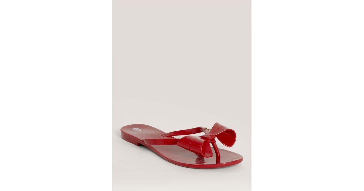 e24099efa Lyst - Melissa Harmonic Big Bow Flip-flops in Red