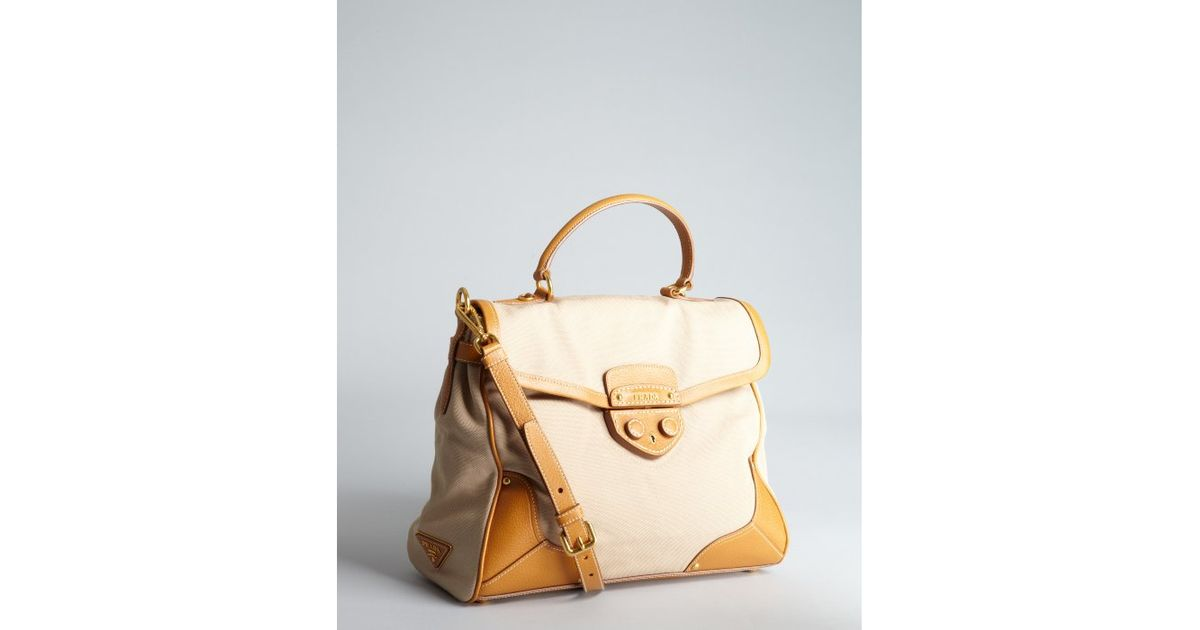 13196c12bae924 ... order lyst prada beige canvas and leather top handle bag in natural  64446 f3f8d