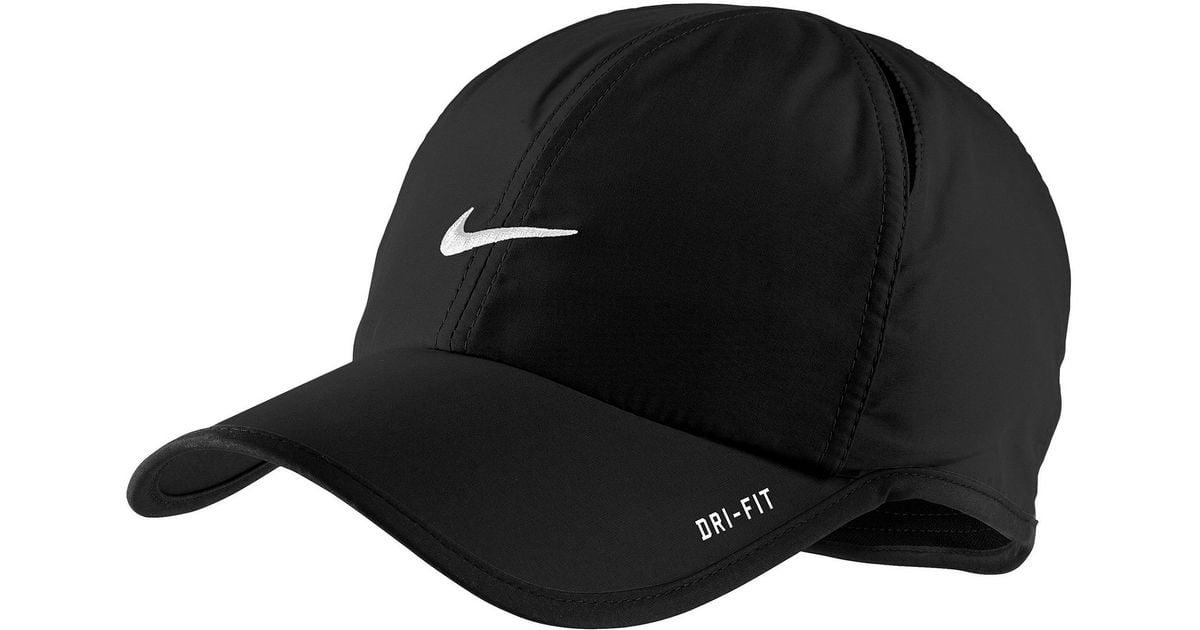 d73136077b67c ... usa lyst nike dri fit feather light cap in black for men 78f68 cb5fa