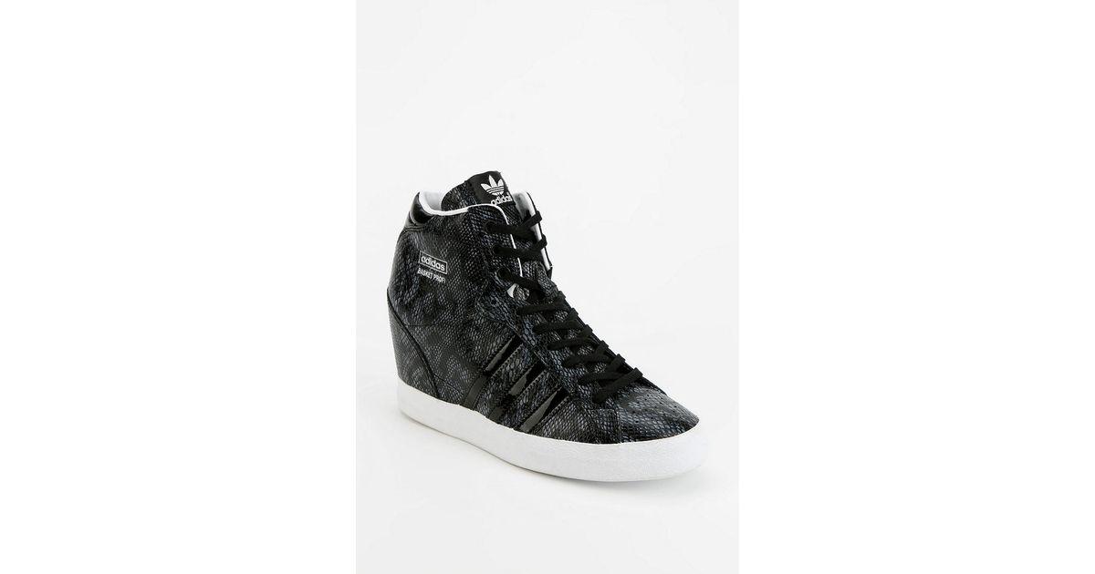 ed87229b2df Lyst - Urban Outfitters Adidas Basket Snakeskin Hidden Wedge Hightop  Sneaker in Black