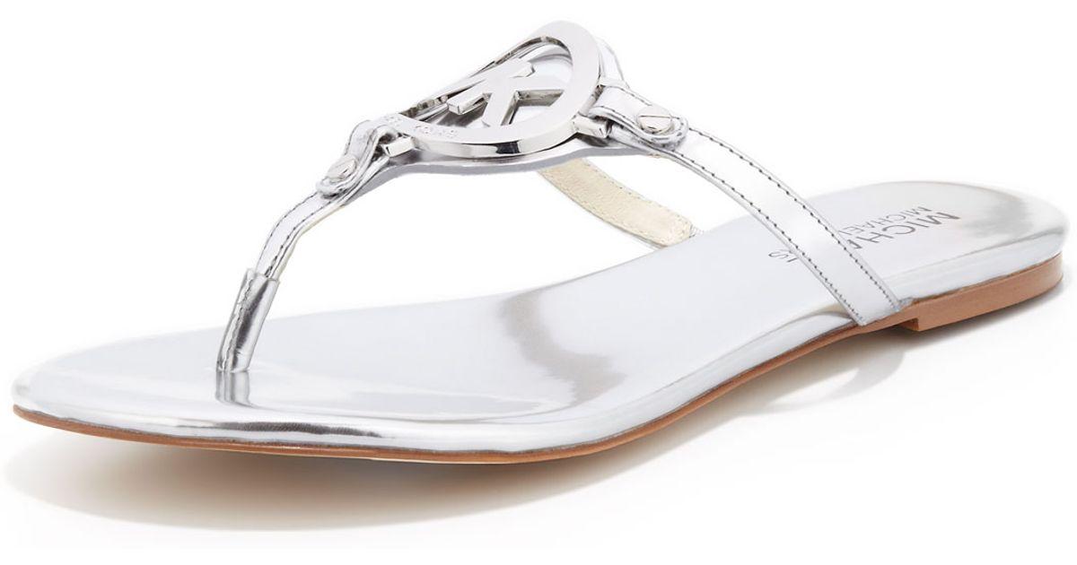ee74d425532f Lyst - Michael Kors Michael Melodie Logo Thong Sandal in Metallic