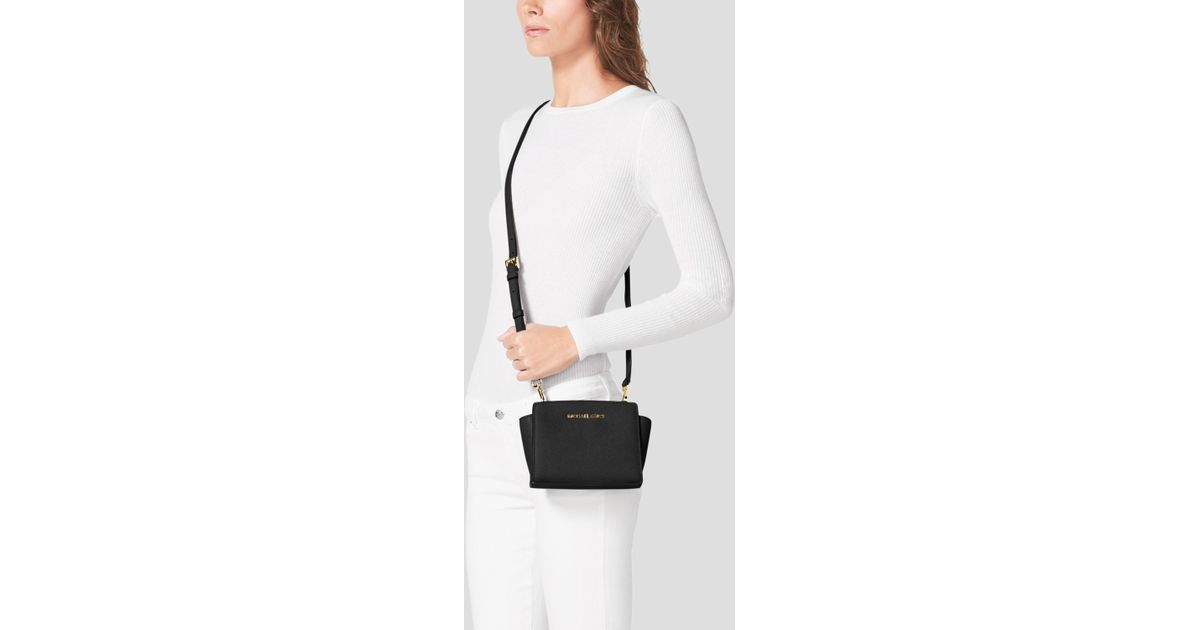 1b45d797b5418 ... coupon code lyst michael michael kors crossbody mini selma in blue  e5b38 6b28e
