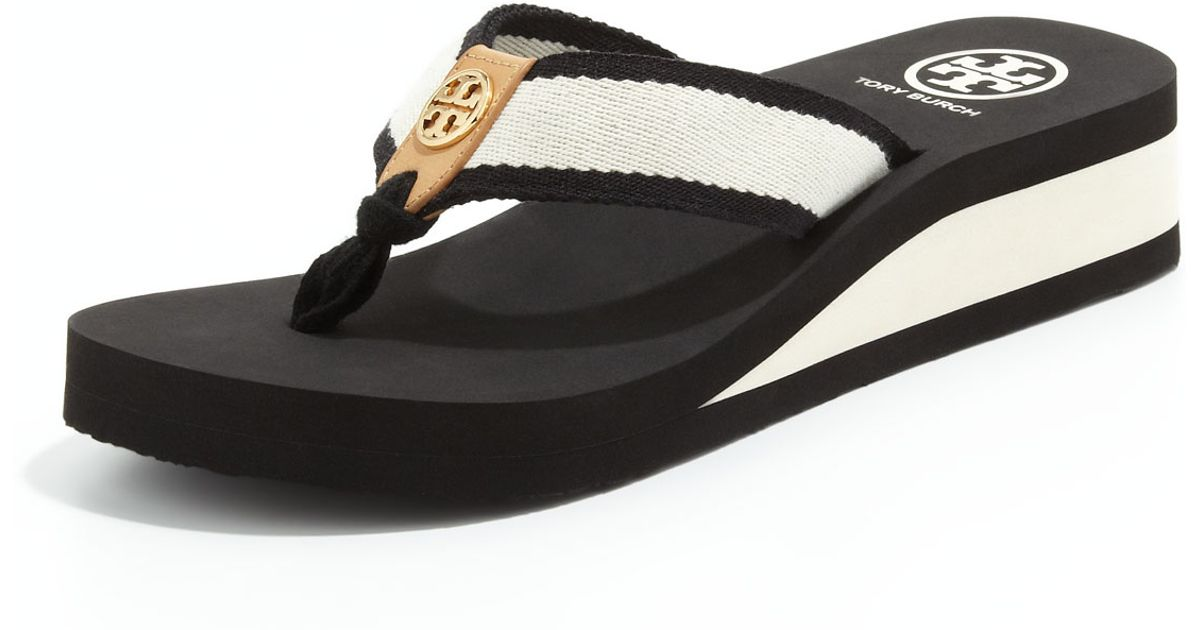 94ca64a7a987 Lyst - Tory Burch Ray Rubber Wedge Flipflop Blackivoryhoney in Black