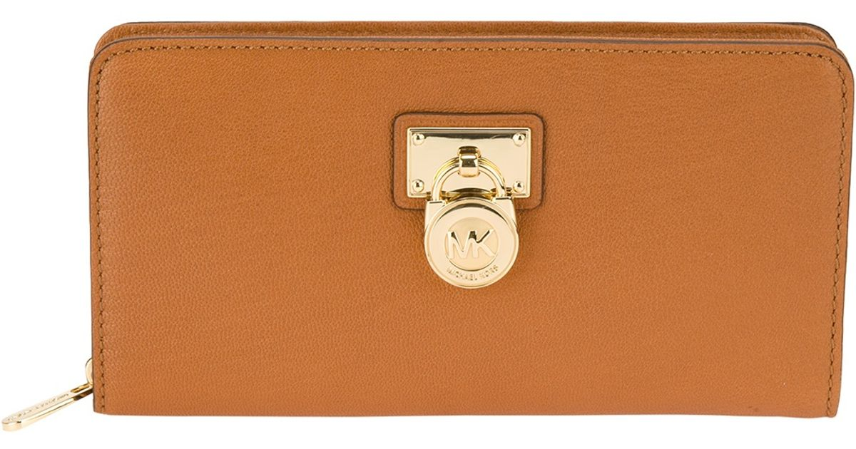 77352a0aa1f Lyst - Michael Kors Padlock Continental Wallet in Brown