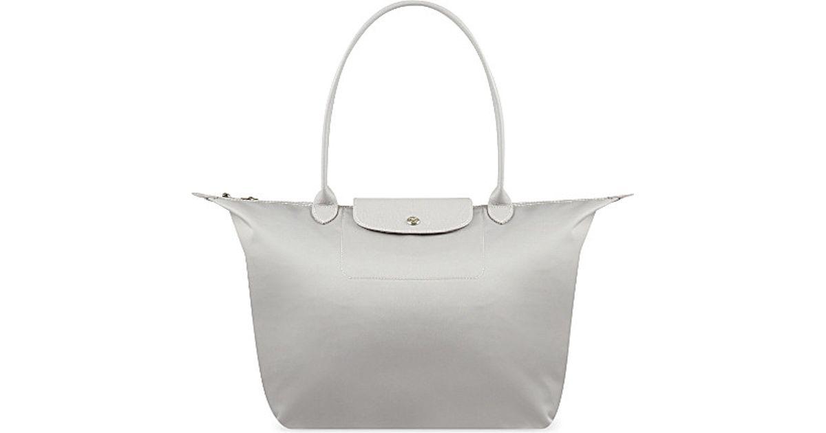 meet 08fe2 c9e45 Longchamp Le Pliage Neo Shoulder Bag in White - Lyst